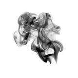 Fumée noire d'isolement sur le blanc Photographie stock libre de droits