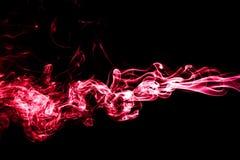 Fumée rouge d'isolement sur le noir Photographie stock