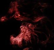Fumée rouge sur le noir Image libre de droits