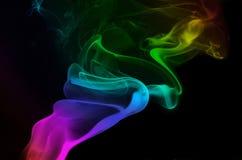 Fumée s'enroulante d'arc-en-ciel Photographie stock libre de droits