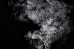 Fumée sur le fond noir Photos libres de droits