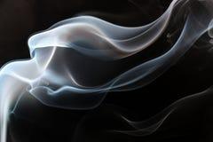 Fumée sur le fond noir Images stock