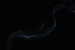 Fumée sur le fond noir Image stock