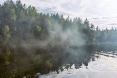 Fumée sur le lac Photographie stock