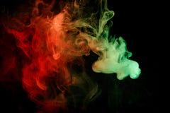 Fumée verte rouge abstraite Weipa Image stock