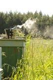 Fumador do apicultor com fumo Imagens de Stock Royalty Free