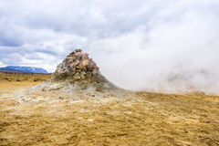 Fumarole evacuating pressurized hot sulfurous gases from volcanic activity in the geothermal area of Hverir Iceland near Lake Myva Stock Photo