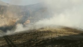 Fumaroles and gas emissions at the craters of the volcano Etna stock video footage