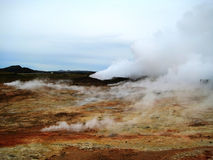 Fumaroles at Gunnuhver (Reykjanes Peninsula, Iceland). A fumarole is an opening in a planet's crust, often in the neighborhood of volcanoes. Those one are Stock Photography