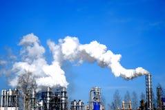Fume en el cielo azul Fotografía de archivo