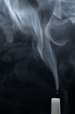 Fume of a white candle Royalty Free Stock Images