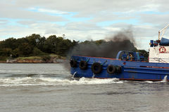 Fumes from a river shannon tug boat Royalty Free Stock Image