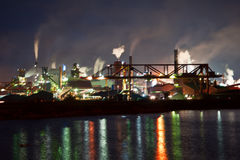 Fumes from steel mill in the harbour stock images