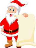 Fumetto del Babbo Natale che tiene carta d'annata in bianco Fotografie Stock Libere da Diritti