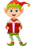 Fumetto sveglio dell'elfo di natale che tiene un regalo Fotografia Stock