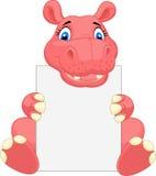 Fumetto sveglio dell'ippopotamo che tiene segno in bianco Fotografia Stock Libera da Diritti
