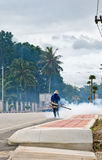 Fumigate mosquito. Man fogging to prevent spread of dengue fever in thailand Royalty Free Stock Images
