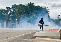 Fumigate mosquito. Man fogging to prevent spread of dengue fever in thailand Royalty Free Stock Photo