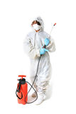 Fumigate pesticide clean. Teenager in white chemical suit with gloves and pesticide spray gun. Boy disinfecting or killing pest isolated on white Royalty Free Stock Image