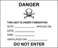 Fumigated unit placard for transport. Official placard for fumigated units. Containers which are shipped from other countries may be fumigated in order to kill Stock Images