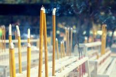 Fumigating yellow chinese sticks Royalty Free Stock Image