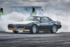 Fuming blue car racing Royalty Free Stock Photography