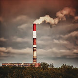 Fuming factory chimney Royalty Free Stock Photography