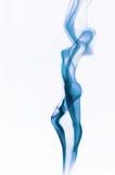 Fuming image of beautiful lady made of smoke. Over white background Stock Photos