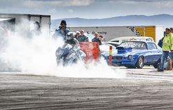Fuming motorcycle racing Royalty Free Stock Images