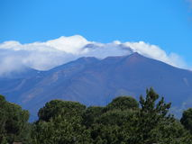 Fuming Mount Etna. In May, the tallest active volcano in Europe, Sicily, Italy Stock Photos