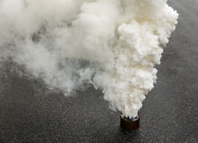 Fuming smoke bomb Stock Photography