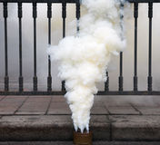 Fuming smoke bomb Stock Image