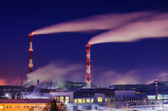 Fuming smokestacks  plant Stock Image