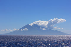 Fuming volcanic island in Indonesia Royalty Free Stock Image