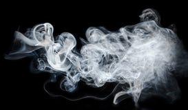 Fumo abstrato no fundo preto Foto de Stock Royalty Free