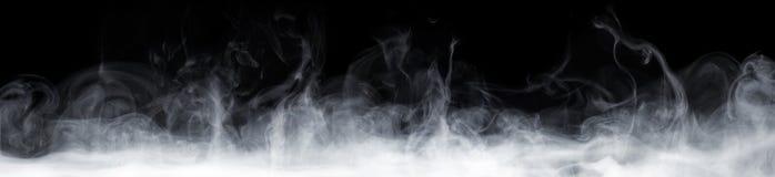 Fumo astratto nello scuro fotografia stock libera da diritti