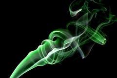 Fumo astratto sui precedenti neri Fotografia Stock
