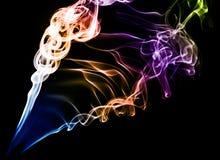 Fumo colorato sul nero Fotografie Stock Libere da Diritti