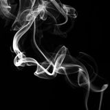 Fumo colorido no fundo preto Fotografia de Stock Royalty Free