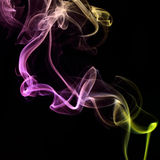 Fumo colorido no fundo preto Imagem de Stock Royalty Free