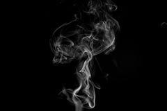Fumo contra um fundo preto Imagem de Stock Royalty Free