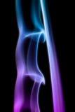 Fumo digitale variopinto astratto su fondo nero artistico Fotografia Stock