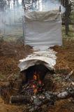Fumo do artesanato derramado para peixes na madeira Foto de Stock