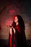 Fumo e vampiro rossi Fotografie Stock