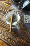 Fumo ed alcool del sigaro Fotografie Stock