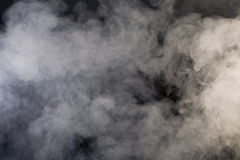 Fumo grigio con fondo nero Fotografia Stock Libera da Diritti
