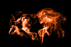 Fumo isolato con luce Fotografie Stock