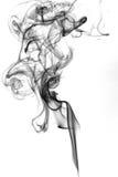 Fumo nero su priorità bassa bianca Fotografie Stock