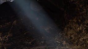 Fumo visível em um feixe de luz filme