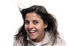 Fun. Happy young woman portrait with wind in her hair Stock Photo